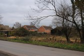 Beging of a new development of new houses in Gidding Road Sawtry. Some of the old barns.