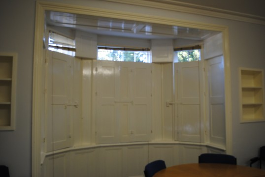 Original wooden shutters in side one of the rooms at Whitehall Sawtry.