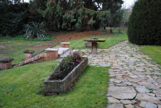 One of the two stone coffins, believed to have come from Sawtry Abbey, in the garden at Whitehall Sawtry.