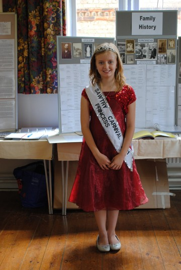 Jade Smythers, the Sawtry Carnival Princess, officiating at the Sawtry History Society's Open Day Weekend, held in the Old School Hall, Sawtry.
