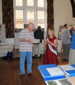 Jade with the Chairman picking the raffle at the, Sawtry History Society's Open Day Weekend, held in the Old School Hall, Sawtry.
