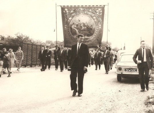 Feast Parade, Sawtry. (Carrying the Odd Fellows banner).