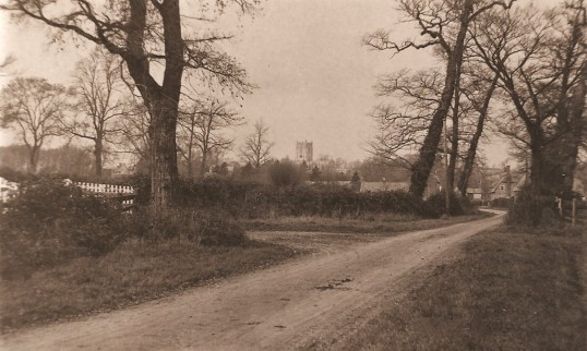 Sawtry Road, Glatton Village. Looking north with the church in background.