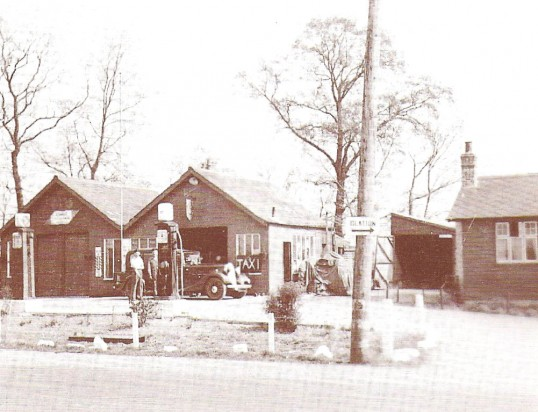 Ratcliffe's Garage, Conington. Rex & Derek Ratcliffe standing next to a Humber motor car.
