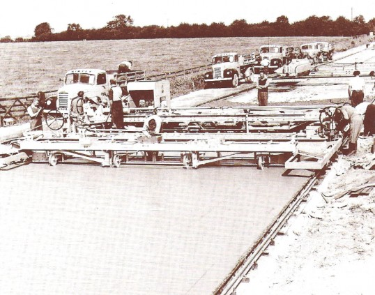 The experimental concrete road at Coppingford, being laid by Wimpy's a well known construction firm.