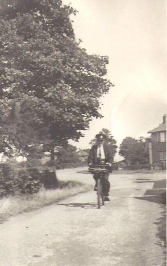 Postman Ernie Bass in Pingle Bank, Holme Village.