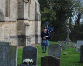 Remembrance Sunday at All Saints Church, Sawtry. (The lone piper plays a lament).