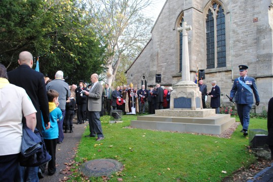 Remembrance Sunday at All Saints Church, Sawtry. (Gathering around the War Memorial).