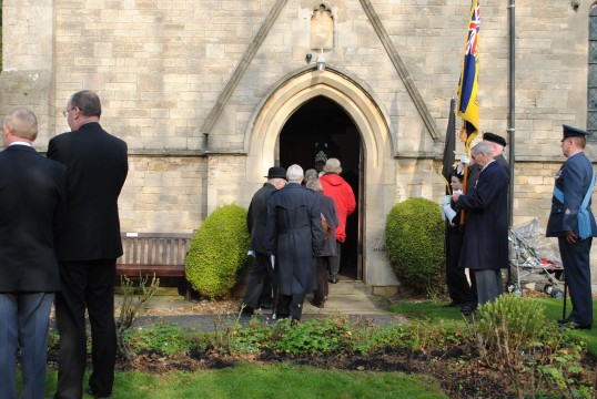 Remembrance Sunday at All Saints Church, Sawtry. (Entering the church for the service).