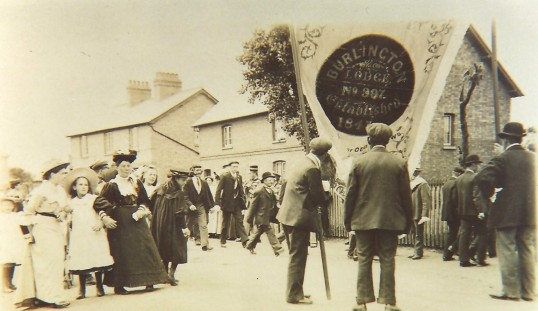 Getting ready for the Feast Parade, Sawtry. Note the Oddfellows Banner (Burlington Lodge)