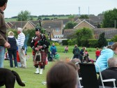 "Diamond Jubilee, ""picnic in the park "" St Judiths Field, Sawtry. A piper ends the day."