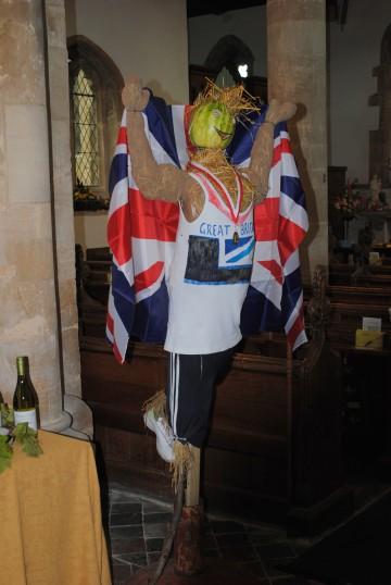 Scarecrows in St. Nicholas Church, Glatton. The Olympic theme.