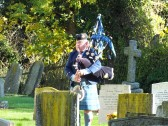 Remembrance Sunday, Sawtry. (A lone piper plays a lament.)