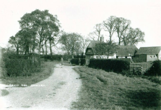 Sprigg's Cottage, Blind Lane, Sawtry. Is the boy  Mr Spriggs and the lady Lady Edna Ginns?
