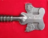 Lion on presentation key of All Saints Church, Sawtry