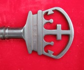 Crown on presentation key of All Saints Church, Sawtry
