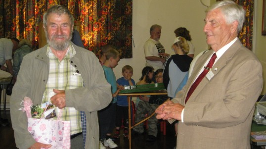 Chairman Gordon Townsend makes a presentation to Harry Milford at the Sawtry History Society Open Day