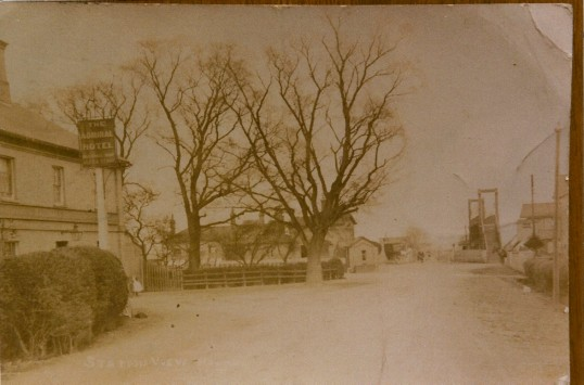 Admiral Wells,known as Admiral Hotel, Holme with station and railway footbridge in the background.