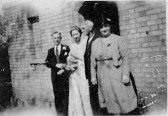 Mr William & Mrs Rosa Stratton outside there cottage on Infield Rd Glatton with there daughter Joan and husband Charles Holmes wedding day.