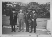 Bill Storey pictured with 3 Chelsea Pensioners, possibly at Chelsea Barracks. Some pensioners attended a Soham Carnival Parade.