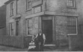 Biull & Nelly Lockwood, plus 2 of their 9 children, outside The Holmes pub, Soham. The cycle shop was on the back.