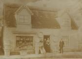 Benjamin, Phoebe and Sarah Bradshaw outside their home/business on Pratt St, Soham. He was a basketmaker.