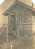 Anne Lane's (nee Pettit) grandfather, Mr. Pettit, in the doorway of the signalbox at either Soham or Barway.