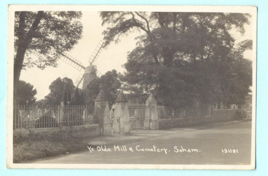 The Cemetery gates, Fordham Road, Soham with windmill visible behind. Date uncertain, but possibly 1920's. The mill was defunct by the 1930's.. Mill cottage