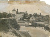 Clark and Butcher's mill, Angle Common, Soham, from the upper floor of the flint granary on Mill Corner. Single track railway in forefront.
