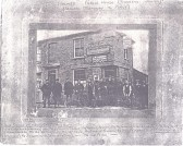 A group of well-known Soham characters posed outside The Holmes public house, run by Mr. and Mrs. Lockwood, in 1920.. The Holmes pub, Soham, 1920
