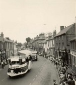 Some of the dressed floats in Soham Carnival Parade, passing along the High Street.