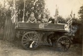 A patriotic float - Alex Hitchings of Soham, 2nd from right in RAF uniform. Possibly part of the Soham Spitfire collection.