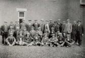 Workforce of Fuller and Johnson, builders, of Soham. Mr. Fuller Snr. on back row, 3rd from left.