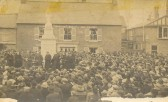 Dedication of Soham War Memorial, 1921.  a postcard by A J Shepherd of Soham. The house behind belonged to Cowells (builders)and dates from the C17th.