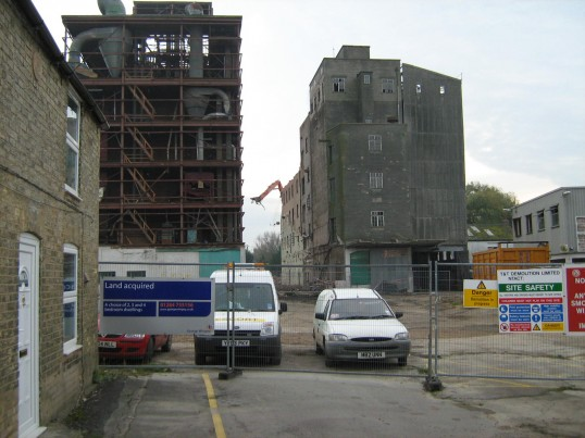 Clark and Butcher's Lion Mills in Soham, under demolition. The house to the left is to remain.