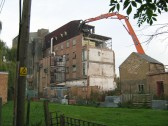 Demolition underway at Clark and Butcher's Lion Mills, Soham. The brick building on the right ihoused the generator.