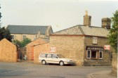 Boyce's seedmerchants on Fountain Lane, Soham. The building was later demolished. URC chapel in the background.