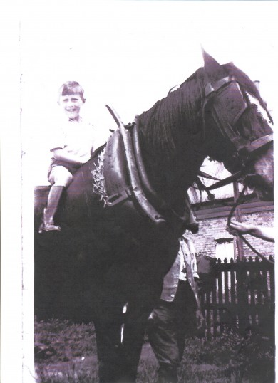 Derek Barker on Tom, the horse, at his grandfather's house at Townsend, Soham. Townsend farmhouse in the background.