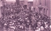 Part of the parade and spectators on Soham High St. Girl with glasses, bottom right, is Elizabeth (Betty) Hills.