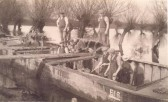 Knox Eden (extreme l) and Lonzo Fordham (2nd r) of Soham, on gault clay barges, working on the flood defences.