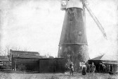 A Soham windmill, possibly near current King's Parade. Couple on right are John and Matilda Pope. Clark's mill?