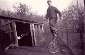 Reg Newman practising on his unicycle in his orchard on Fordham Rd, Soham.