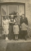 Anne Willett (left) and her cousin Alex Hitchings (2nd from right, back) of Soham, circa 1949/50.