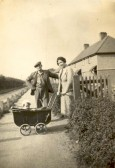 Florence and Ernie Hitchings with baby son Alex, at Orchard Row, Downfields, Soham.