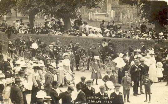Crowds on Soham High St, near the church wall, on Hospital Sunday 1909.
