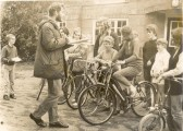 Preparing for the Youth Club cycle ride outside Soham Church hall, being given instructions by the Curate, Ian Woodroffe.