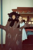 Nicola Johnson as the Cheshire Cat and Jennifer Roberts as Alice in St. Andrew's C of E Primary's 'Alice in Wonderland.