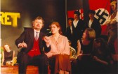 David Tickner as Herr Schultz and Bev Lewis as Fraulein Schneider, with other cast members, in Soham Village College's 'Cabaret'.