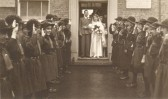 Wedding of Ida Martin to A.A. (Bob) Wright, with a Girl Guides guard of honour, at Soham Baptist Church. It snowed! Mary Ames on the left.
