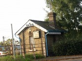 An outbuilding at St Neots Railway station that served as an HQ for a taxi rank, in September 2008, formerly the weighbridge office.
